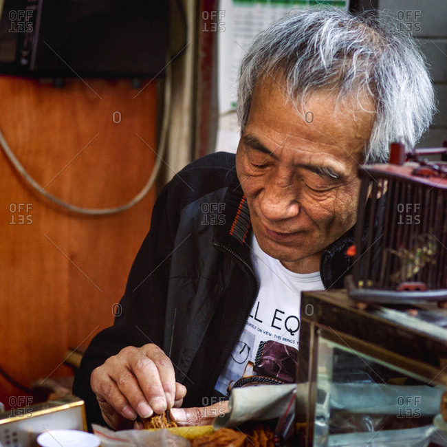 Muslim Quarter, Xi'an, China - April 25, 2016: Man selling crickets