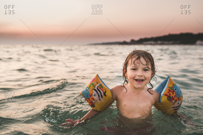 Little girl swimming in the ocean