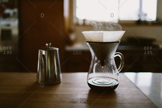 Pour over coffee dripping and steaming.