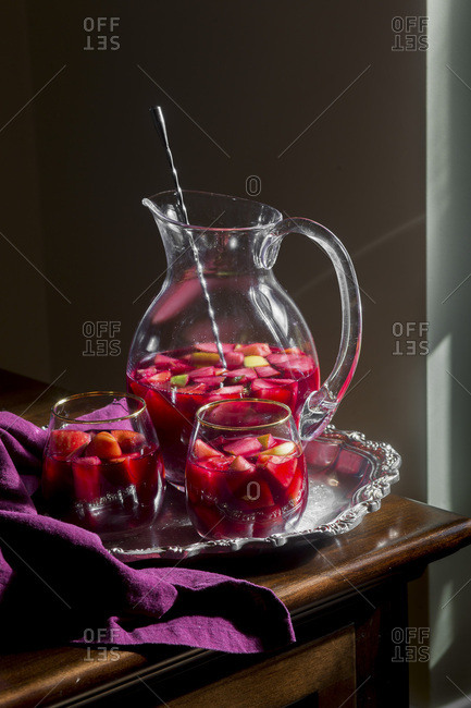 Pitcher and two glasses of sangria on a serving tray