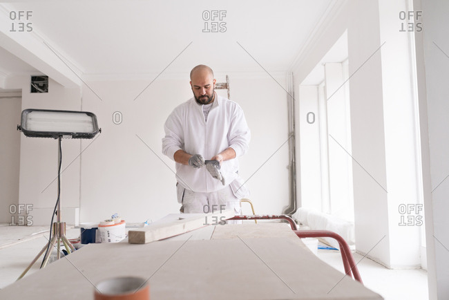 Painter removing his gloves at a home improvement job