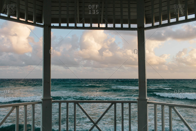 View of an ocean at sunset from a gazebo