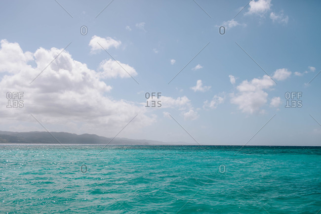 Tropical blue sea, coastline and sky