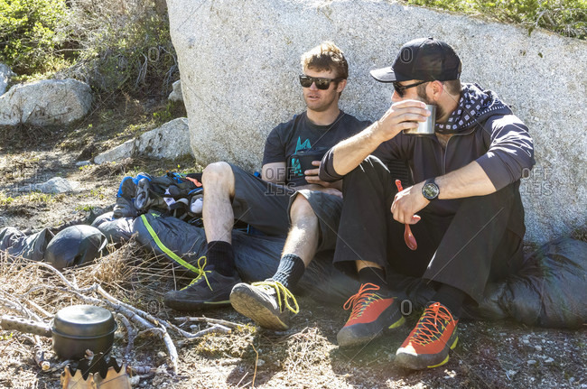 Two Hikers Takes A Break And Enjoys A Warm Coffee While Hiking Towards Utah's Lone Peak Located In The Wasatch Mountains