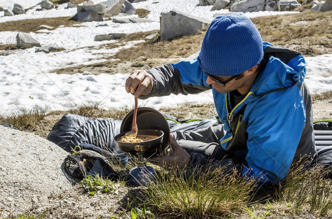 A Man Cooks Breakfast While Camping In The Lone Peak Wilderness In Utah\'s Wasatch Mountains