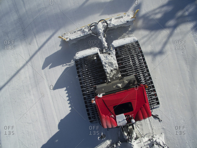 High Angle View Of A Pistenbully Snowcat Operation From A Drone