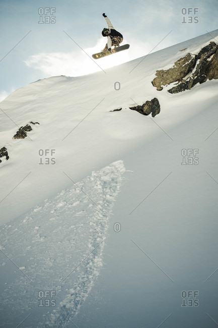 Mark Hoyt Jumping Off A Cliff In The Colorado Backcountry