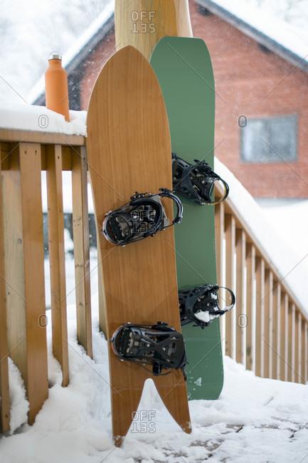 Snowboards On Porch In Niseko, Japan