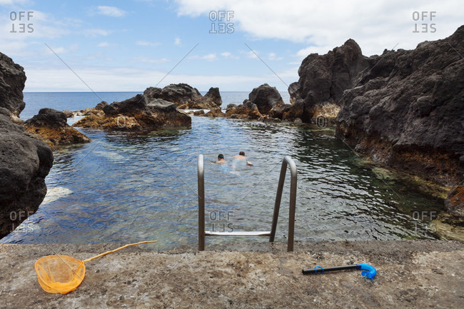 Father And Son Snorkeling In The Crystal Clear Ocean Water In Pico Island, Azores, Portugal