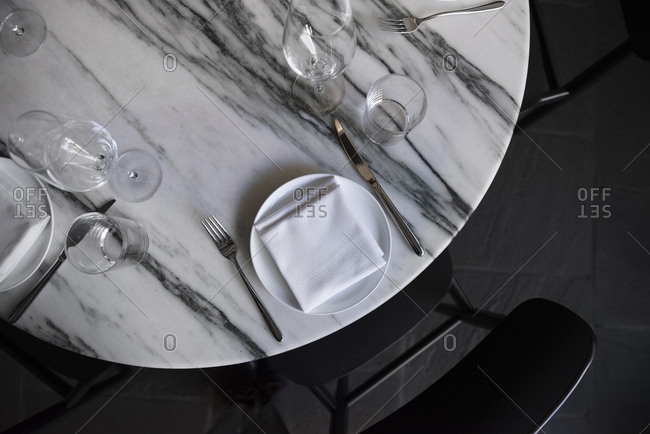 Marble table set for dinner