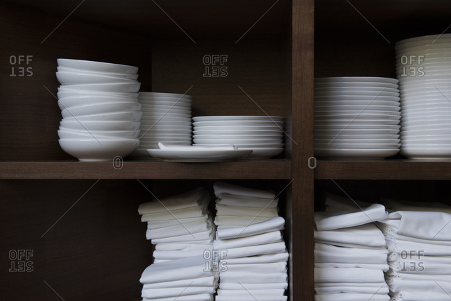 Dishes and napkins on shelves