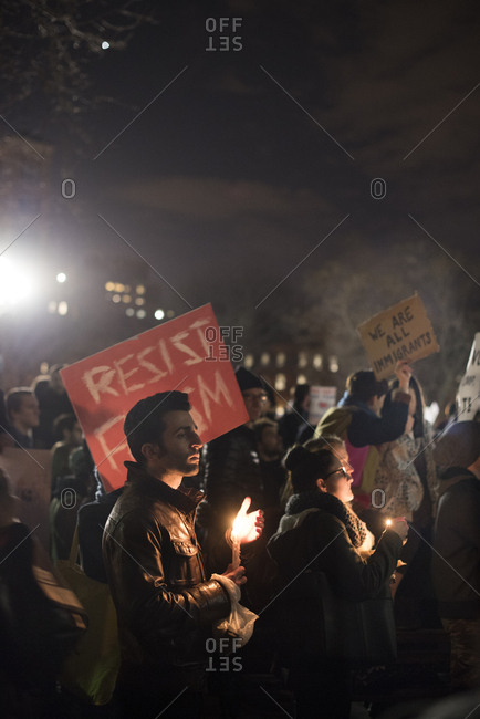 Washington Square Park, New York City - January 25, 2017: Activists with signs and candles