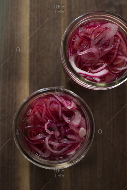 Red onions in pickling jar