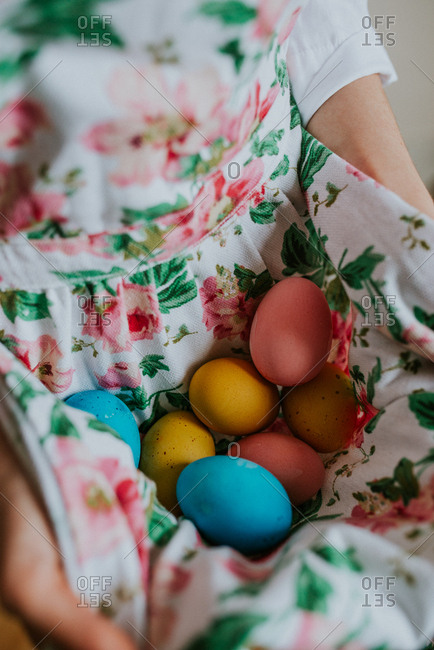 Woman with dyed eggs in dress