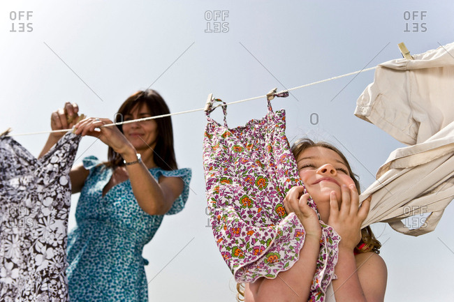 Girl rubbing clothes on face