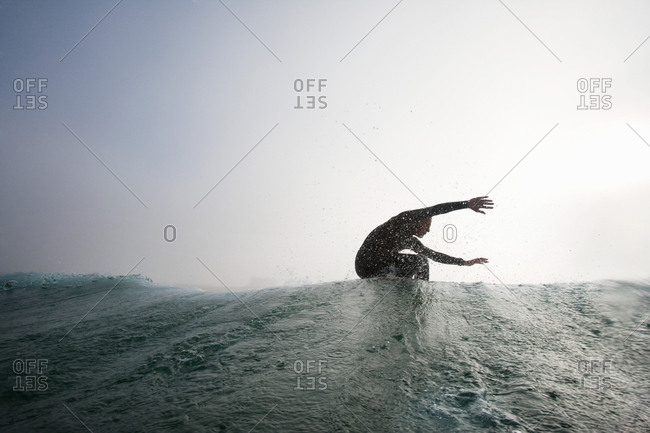 Man surfing a wave