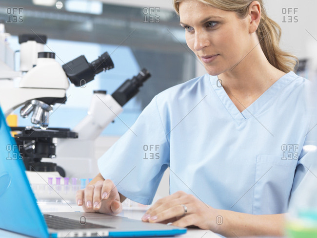Medical scientist viewing patients test results on a computer