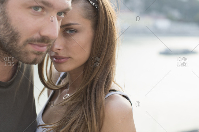 Portrait of sultry young couple on waterfront,  Budapest, Hungary