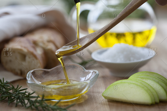 Pouring olive oil onto a spoon