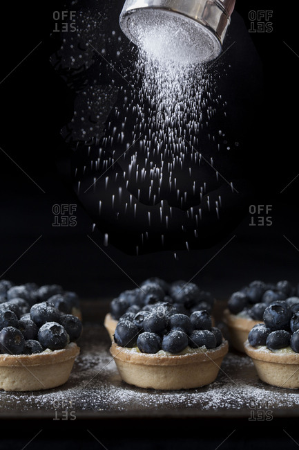 Blueberry tarts with a dusting of powdered sugar