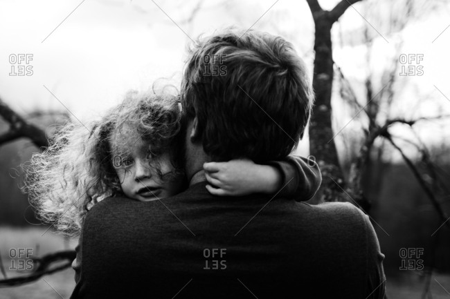 Child hugging father