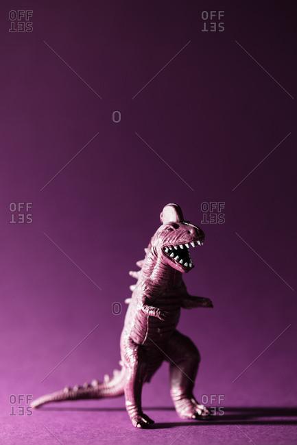 Portrait of a toy Tyrannosaurus