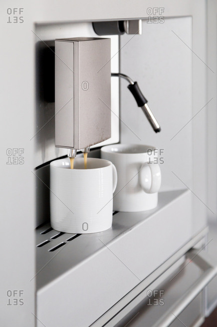 Automated coffee maker pouring a cup