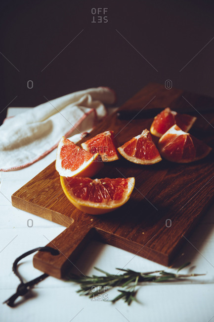 Pieces of grapefruit on a cutting board
