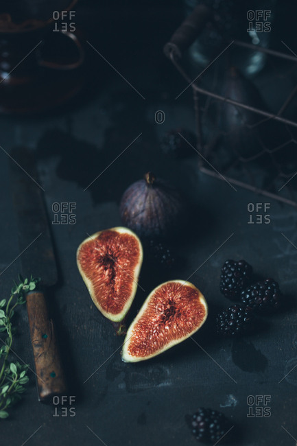 Figs and blackberries in dark setting