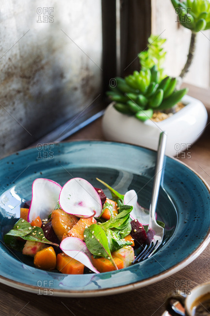 Bowl of salad on window sill