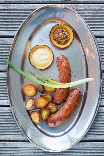 Sausages and cooked potatoes