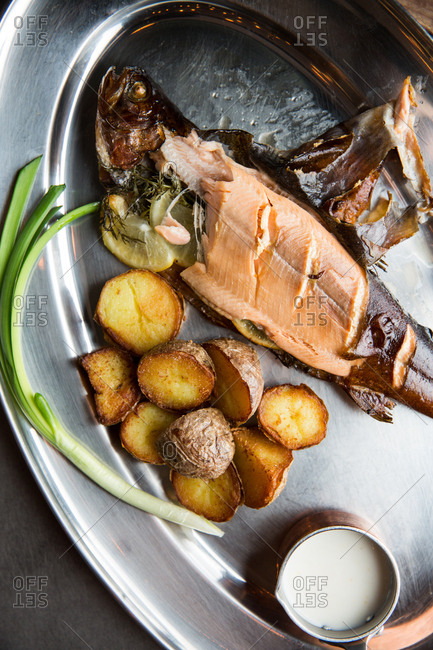 Fish with peeled skin served with potatoes
