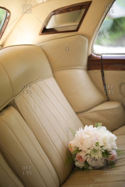 Bridal bouquet in back seat of car