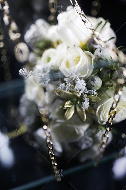 Silver chain draped across a bouquet