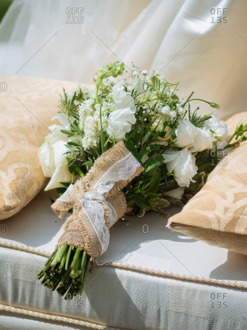 A wedding bouquet on cushion