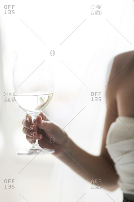 Bride holding a wine glass