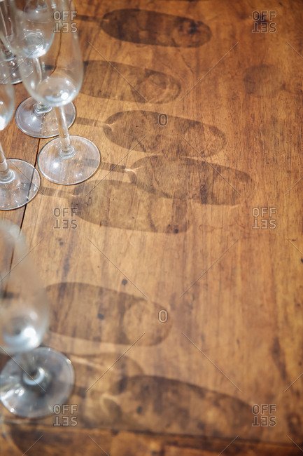 Glass shadows on wood table