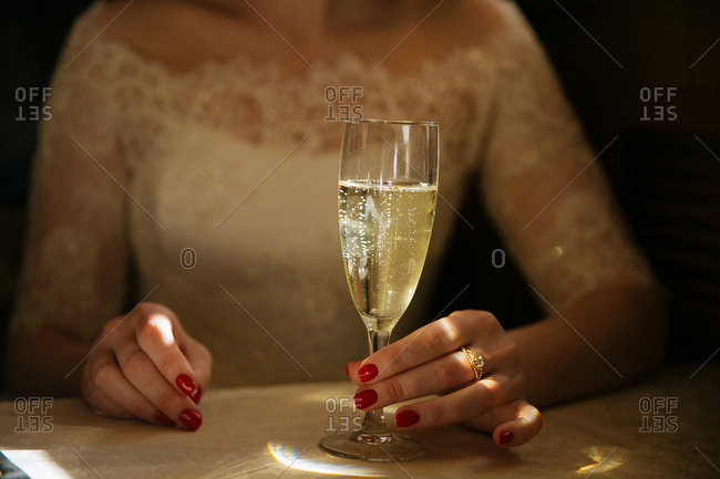 Woman in formal dress with champagne
