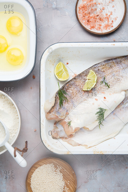 Fish in pan with breading ingredients