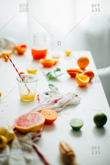 Table with citrus fruit and juice