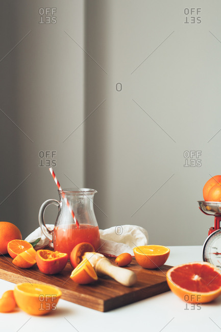 Citrus fruit in a pitcher