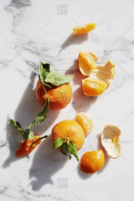 Overhead view oranges and peelings
