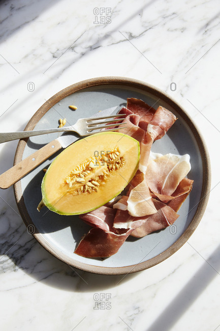 Melon and prosciutto on a plate