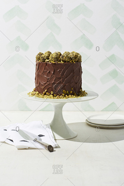 Orange cake with mocha icing and pistachios