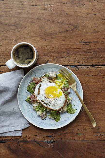 Mashed red potato, pesto and a fried egg