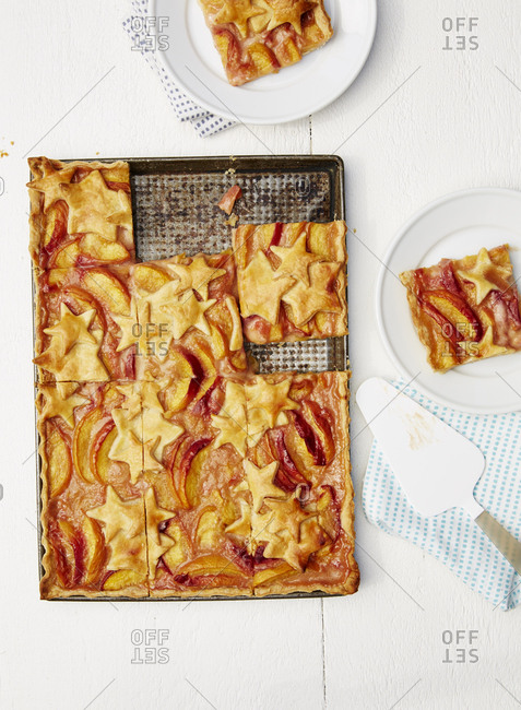 Peach slab pie sliced into portions