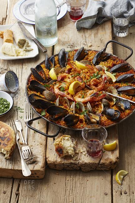 Seafood Paella on a rustic wood table