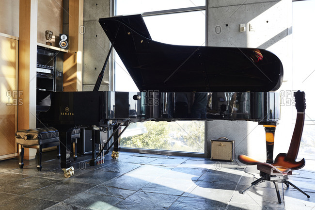 Los Angeles, California - February 24, 2017: Room with grand piano in home in Hollywood Hills