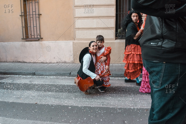 Barcelona, Spain - March 15, 2017: Mother and son dressed in carnival costumes