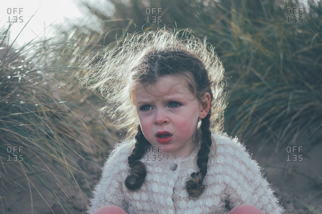 Portrait of a little girl outdoors with frizzy hair